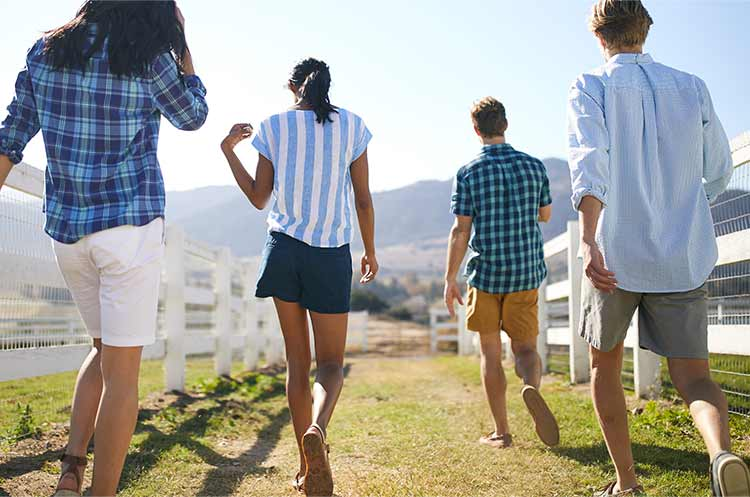 People outdoors in shorts.