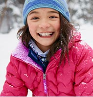 Smiling girl in a blue JACKET.
