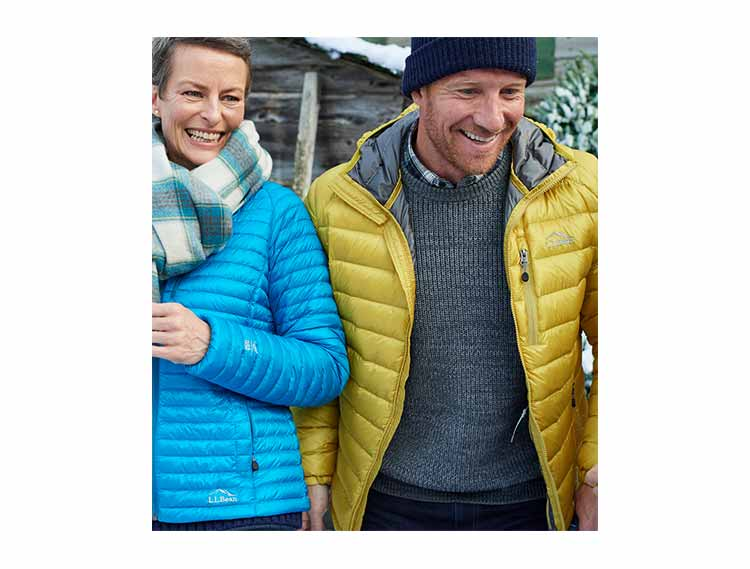 Man and Woman in Ultralight 850 Down Outerwear.