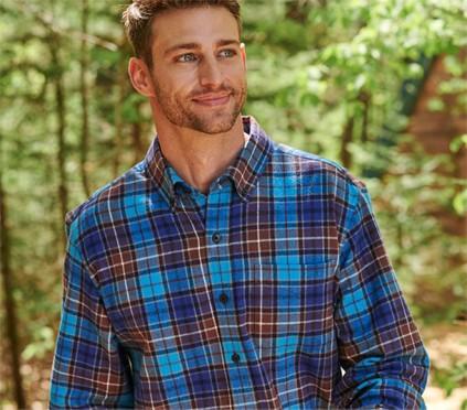 Man wearing flannel shirt outside
