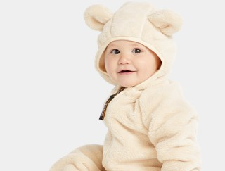 Smiling toddler in a one piece fleece suit with ears.