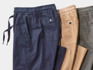 Close-up of 3 pairs of folded pants.