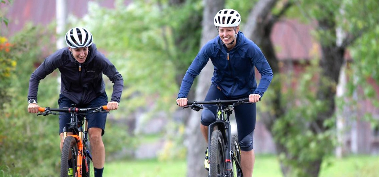Lea and Frazier riding mountain bikes.