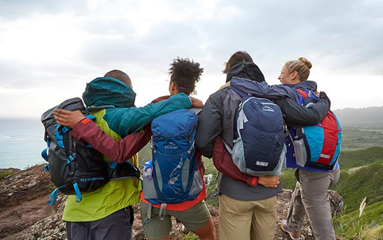 Men and Women wearing L.L.Bean Back Packs viewing the landscape.