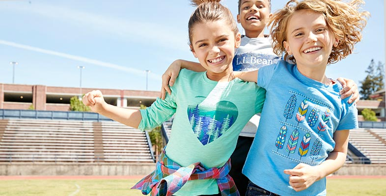 Two girls and a boy wearing L.L.Bean Tee Shirts playing outside.