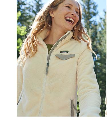 Women wearing L.L.Bean Fleece outside smiling.